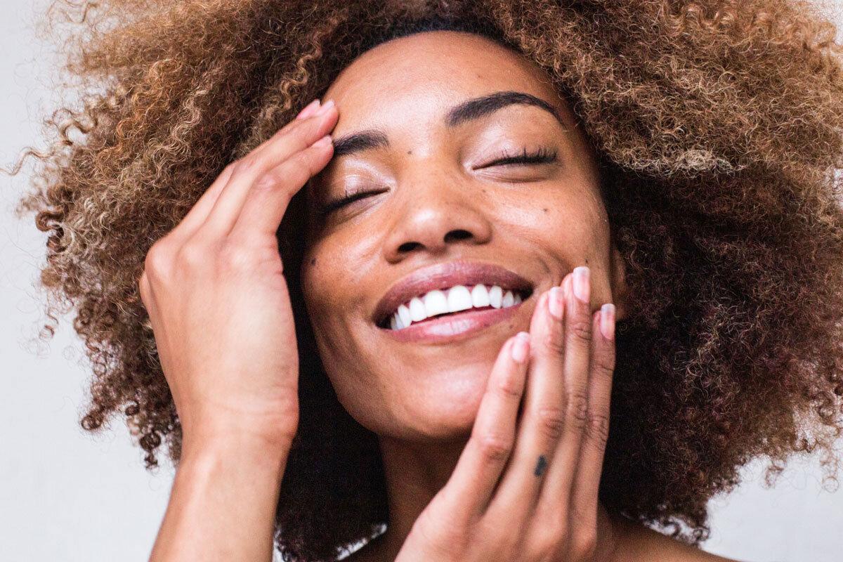 Young woman applies DIY honey skin care face mask