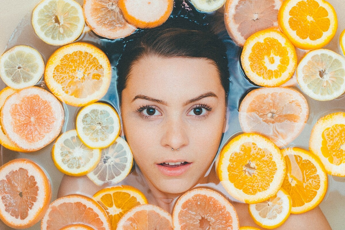 Woman using DIY skincare recipes based on honey and natural products